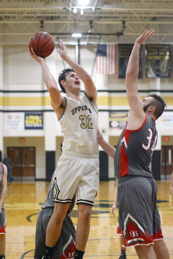 Upperman's Alex Rush, left, goes up for a layup during the Bees' 67-35 win over Red Boiling Springs Saturday at UHS.