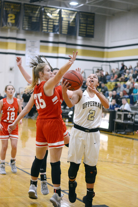 Upperman's Aiyana Levy, right, goes up for a layup during the Lady Bees' 66-38 win over Red Boiling Springs Saturday at UHS.