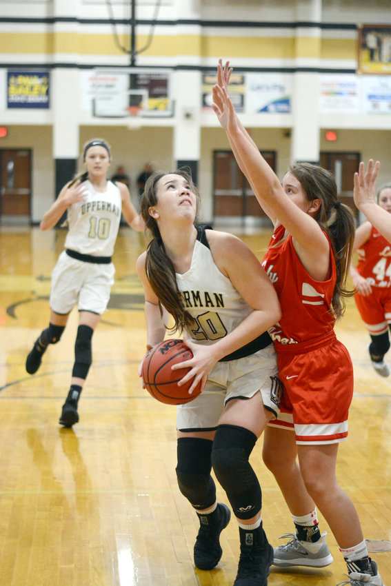 Upperman's Torie Brooks, left, looks to go up for a layup during the Lady Bees' 66-38 win over Red Boiling Springs Saturday at UHS.