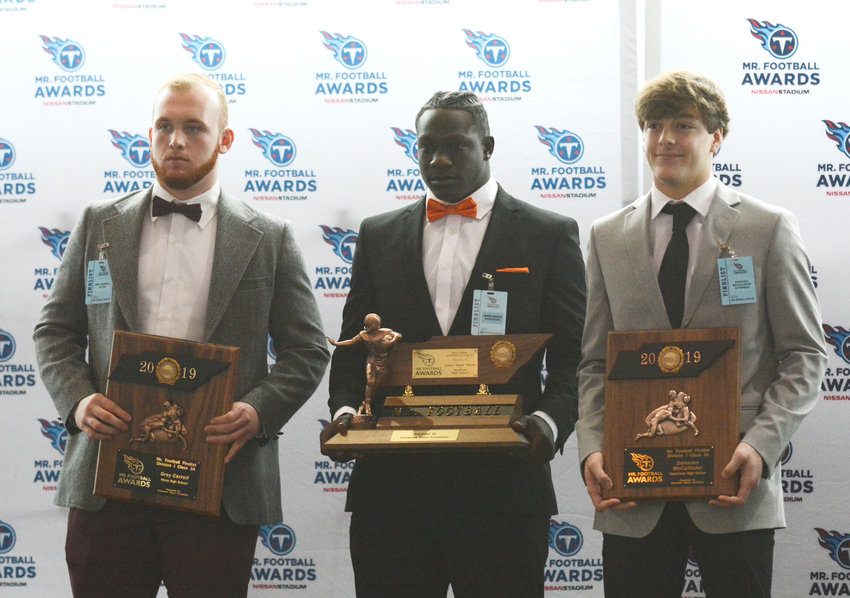 Upperman High School's Donoven McCallister, far right, was honored as a finalist for the Tennessee Titans Mr. Football Award. He is joined by Alcoa's Grey Carroll and Stratford's James Moore.