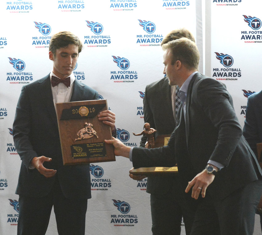Livingston Academy's Will McDonald, far left, receives his plaque for being named a finalist for the Mr. Football Award.