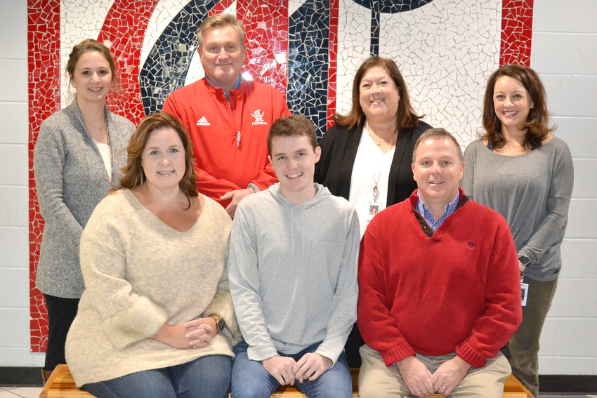 Celebrating Eli Apple's rare, perfect ACT score are, front row, from left, Kerri Apple, Eli Apple and Jeff Apple; back row, CHS teachers, counselors and administrators, from left, Emily Chambers, Mat Petett, Kathy Ligon and Stephanie Hardin.