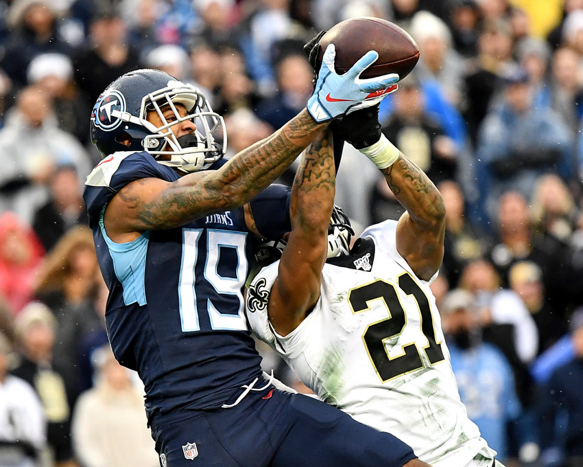 Tennessee Titans wide receiver Tajae Sharpe (19) tries to make the catch in the end zone on a fourth down play late in the fourth quarter of an NFL game against the New Orleans Saints Sunday, Dec. 22, 2019, at Nissan Stadium in Nashville, Tenn.