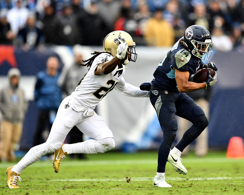 Tennessee Titans wide receiver Kalif Raymond (14) makes the catch but takes a big hit and loses the ball in the fourth quarter of an NFL game against the New Orleans Saints Sunday, Dec. 22, 2019, at Nissan Stadium in Nashville, Tenn.