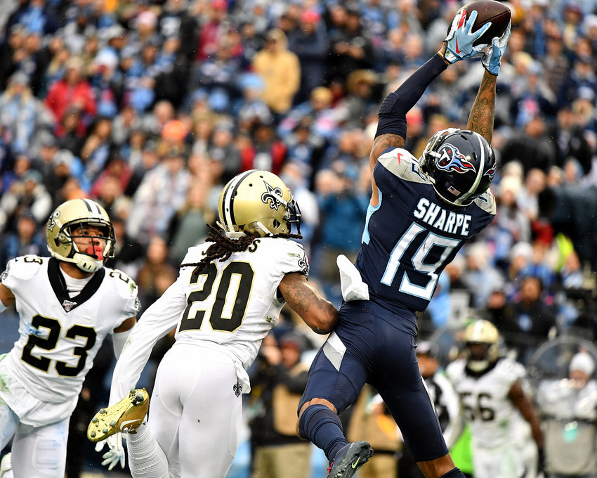 Tennessee Titans wide receiver Tajae Sharpe (19) goes high for the grab in the second half of an NFL game against the New Orleans Saints Sunday, Dec. 22, 2019, at Nissan Stadium in Nashville, Tenn.