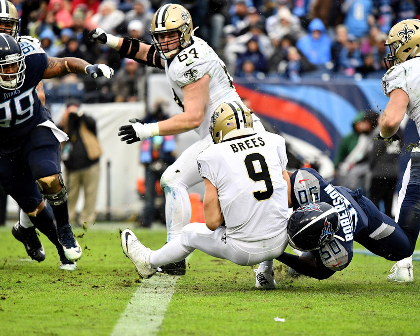 Tennessee Titans linebacker Derick Roberson (50) gets to New Orleans Saints quarterback Drew Brees (9) for a sack near the goal line in the second half of an NFL game Sunday, Dec. 22, 2019, at Nissan Stadium in Nashville, Tenn.