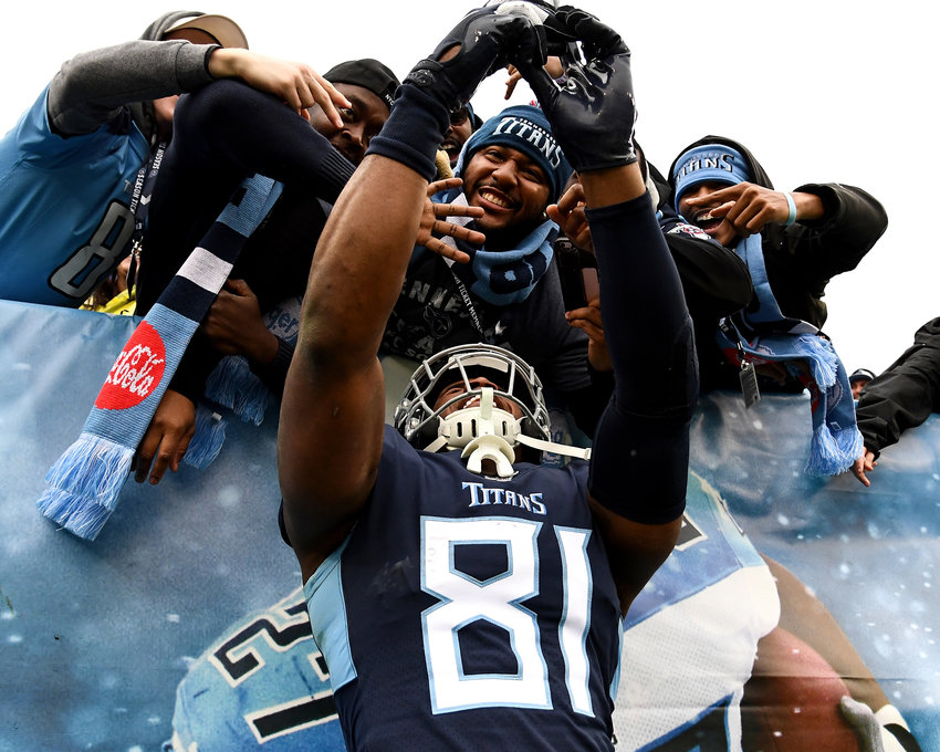 Tennessee Titans tight end Jonnu Smith (81) celebrates with fans in the second half of an NFL game against the New Orleans Saints Sunday, Dec. 22, 2019, at Nissan Stadium in Nashville, Tenn.