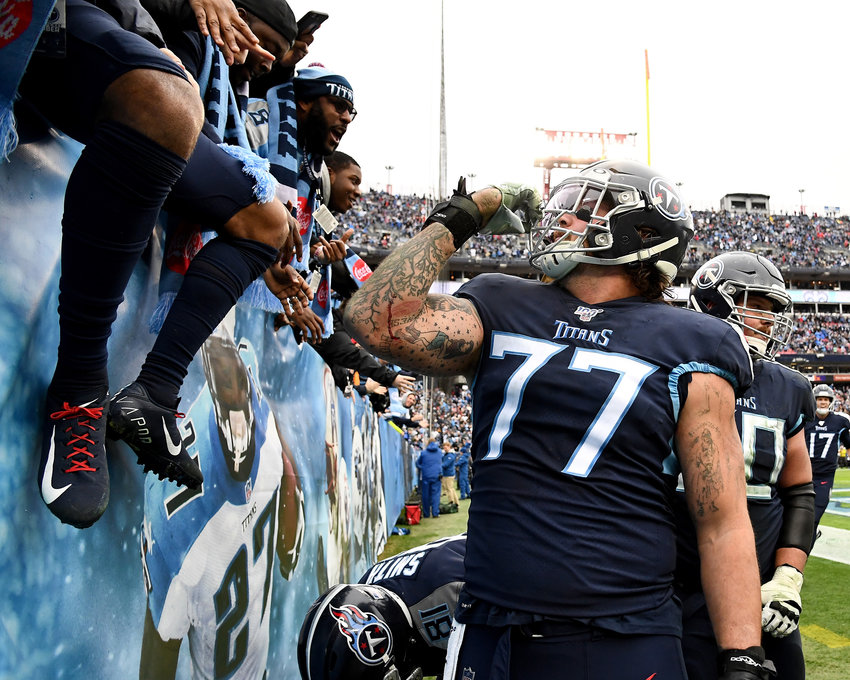 Tennessee Titans offensive tackle Taylor Lewan (77) celebrates with the crown during the second half of an NFL game against the New Orleans Saints Sunday, Dec. 22, 2019, at Nissan Stadium in Nashville, Tenn.