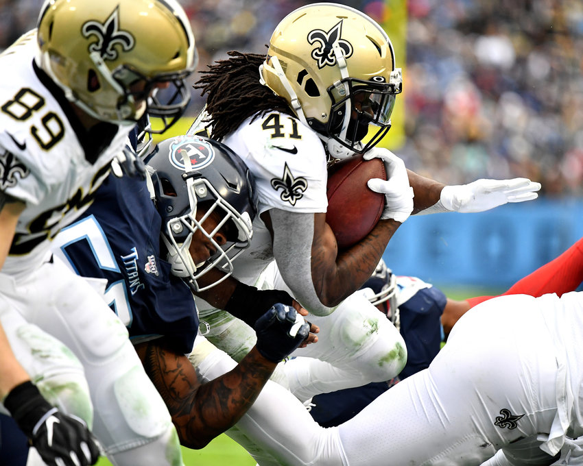 New Orleans Saints running back Alvin Kamara (41) breaks through the line on his way to a touchdown during the second half of an NFL game against the Tennessee Titans Sunday, Dec. 22, 2019, at Nissan Stadium in Nashville, Tenn.