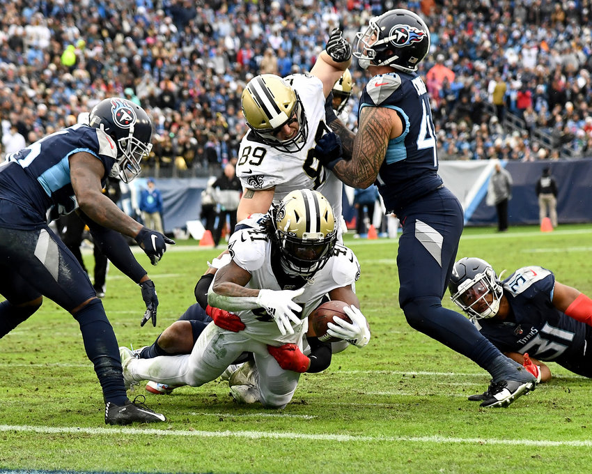 New Orleans Saints running back Alvin Kamara (41), and former Tennessee Volunteer standout, lunges for the goal line during the second half of an NFL game against the Tennessee Titans Sunday, Dec. 22, 2019, at Nissan Stadium in Nashville, Tenn.