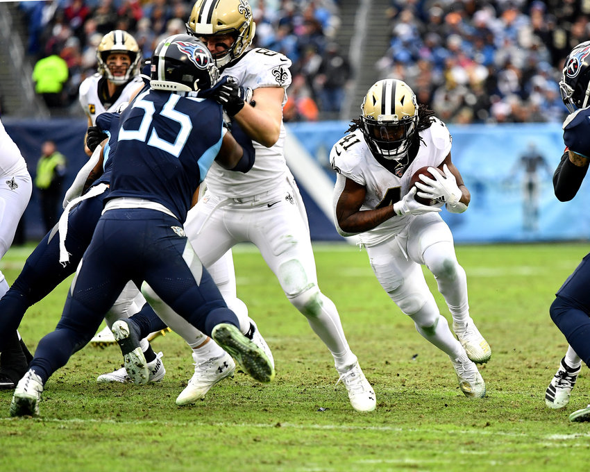 New Orleans Saints running back Alvin Kamara (41), and former Tennessee Volunteer standout, finds a hole in the line during the second half of an NFL game against the Tennessee Titans Sunday, Dec. 22, 2019, at Nissan Stadium in Nashville, Tenn.
