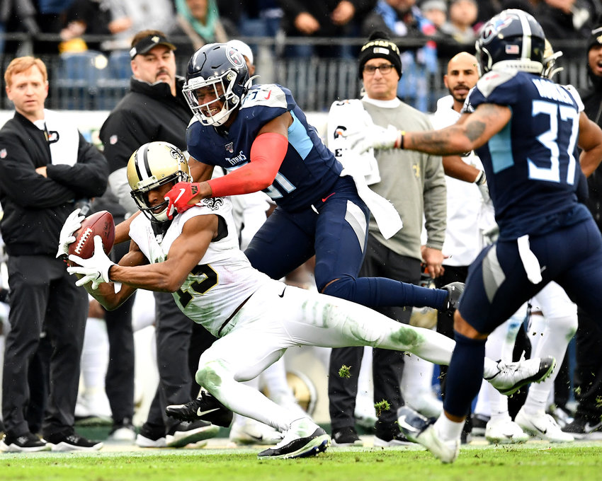Tennessee Titans free safety Kevin Byard (31) tries to cover New Orleans Saints wide receiver Michael Thomas (13) in the second half of an NFL game Sunday, Dec. 22, 2019, at Nissan Stadium in Nashville, Tenn.