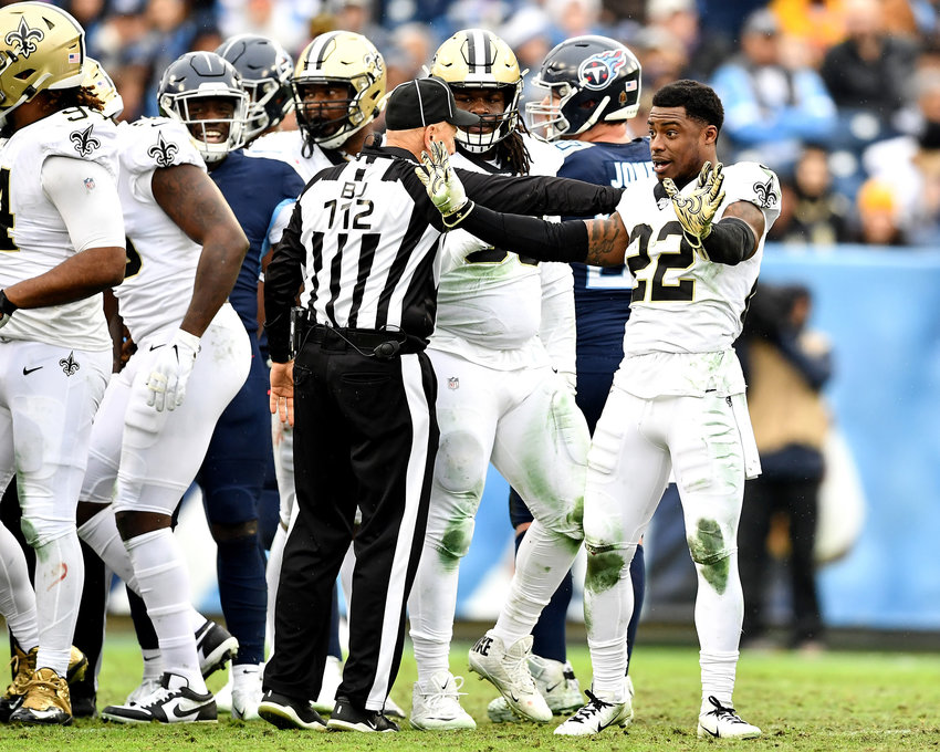 New Orleans Saints defensive back Chauncey Gardner-Johnson (22) tries to explain to back judge Tony Steratore (112) why he's missing his helmet during the first half of an NFL game against the Tennessee Titans Sunday, Dec. 22, 2019, at Nissan Stadium in Nashville, Tenn.