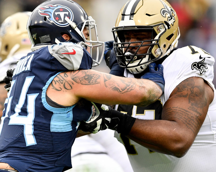 Tennessee Titans outside linebacker Kamalei Correa (44) and New Orleans Saints offensive tackle Terron Armstead (72) face off in the first half of an NFL game Sunday, Dec. 22, 2019, at Nissan Stadium in Nashville, Tenn.