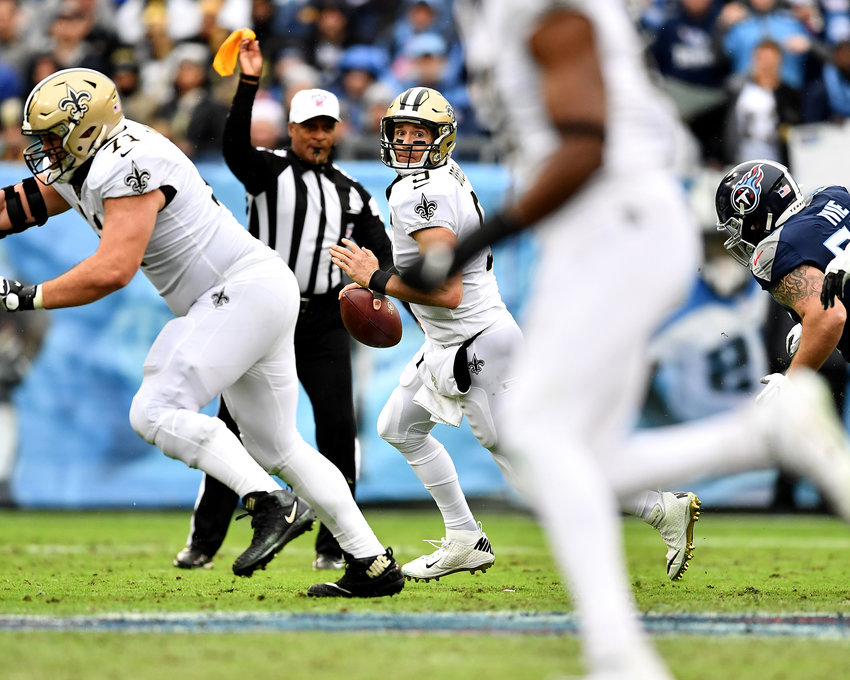 New Orleans Saints quarterback Drew Brees (9) scrambles under pressure during the first half of an NFL game against the Tennessee Titans Sunday, Dec. 22, 2019, at Nissan Stadium in Nashville, Tenn.