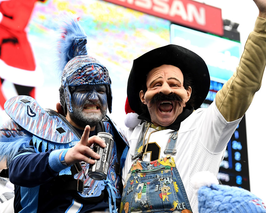 Fans in the stands, from the first half of an NFL game between the New Orleans Saints and the Tennessee Titans Sunday, Dec. 22, 2019, at Nissan Stadium in Nashville, Tenn.
