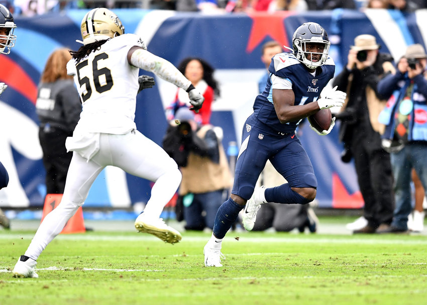 Tennessee Titans wide receiver A.J. Brown (11) tries to avoid the tackle by New Orleans Saints outside linebacker Demario Davis (56) during the first half of an NFL game Sunday, Dec. 22, 2019, at Nissan Stadium in Nashville, Tenn.