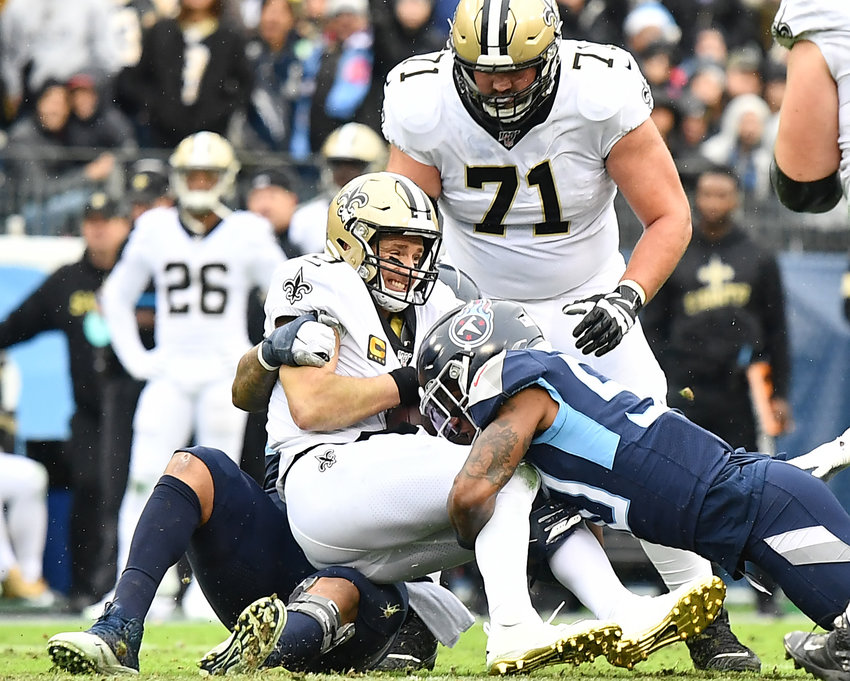 Tennessee Titans linebacker Derick Roberson (50) sacks New Orleans Saints quarterback Drew Brees (9) in the first half of an NFL game Sunday, Dec. 22, 2019, at Nissan Stadium in Nashville, Tenn.
