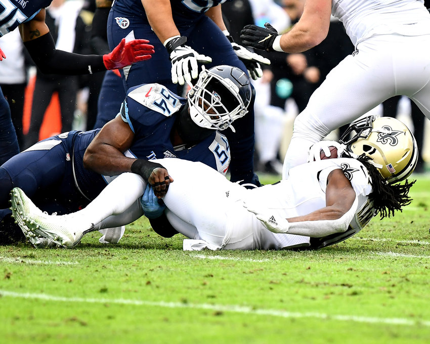 Tennessee Titans inside linebacker Rashaan Evans (54) tackles New Orleans Saints running back Alvin Kamara (41) during the first half of an NFL game Sunday, Dec. 22, 2019, at Nissan Stadium in Nashville, Tenn.