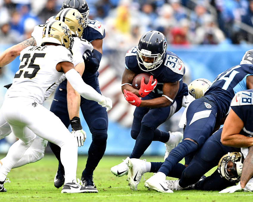 Tennessee Titans running back Dion Lewis (33) looks for a gap in the line in the first half of an NFL game against the New Orleans Saints Sunday, Dec. 22, 2019, at Nissan Stadium in Nashville, Tenn.