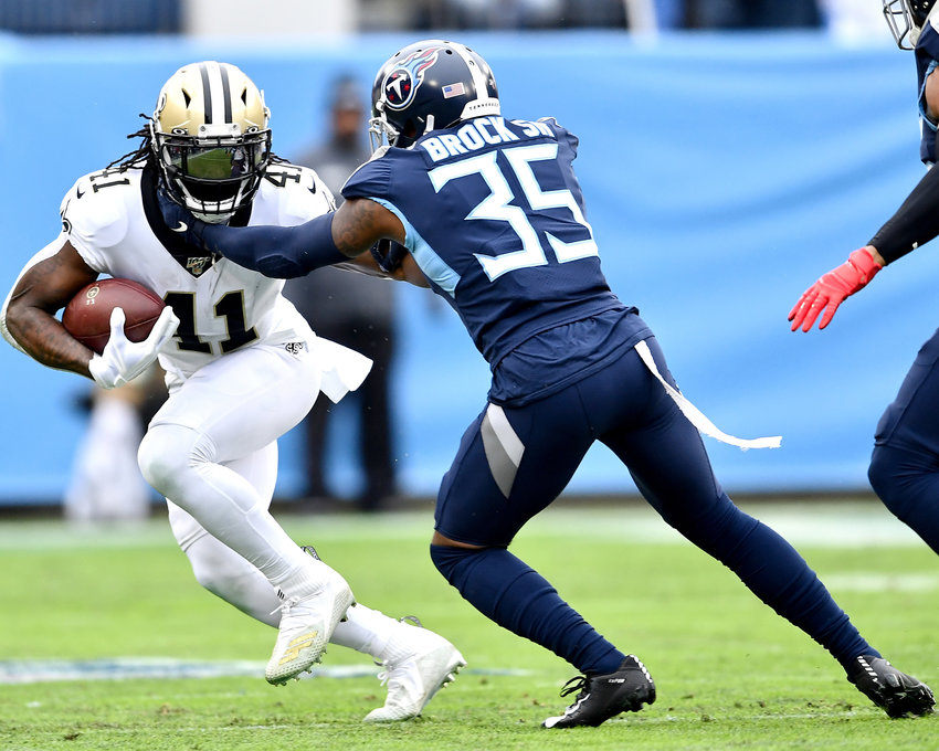 New Orleans Saints running back Alvin Kamara (41) looks to avoid being tackled by Tennessee Titans defensive back Tramaine Brock (35) in the first half of an NFL game Sunday, Dec. 22, 2019, at Nissan Stadium in Nashville, Tenn.