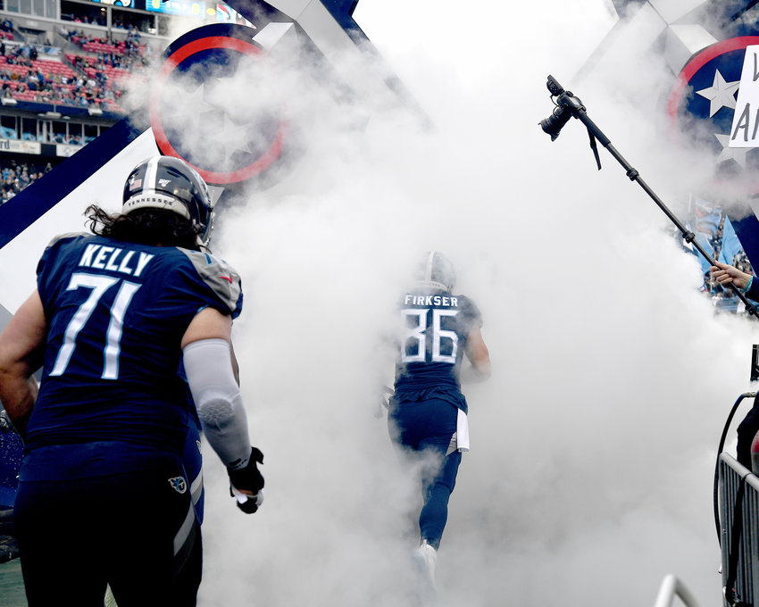 Tennessee Titans tight end Anthony Firkser (86) and offensive tackle Dennis Kelly (71) enter the stadium prior to an NFL game against the New Orleans Saints Sunday, Dec. 22, 2019, at Nissan Stadium in Nashville, Tenn.