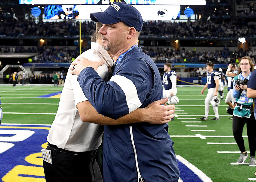 Penn State Nittany Lions head coach James Franklin and Memphis Tigers head coach Ryan Silverfield are seen at midfield following the Cotton Bowl NCAA football game Saturday, Dec. 28, 2019, at AT&T Stadium in Arlington, Texas.