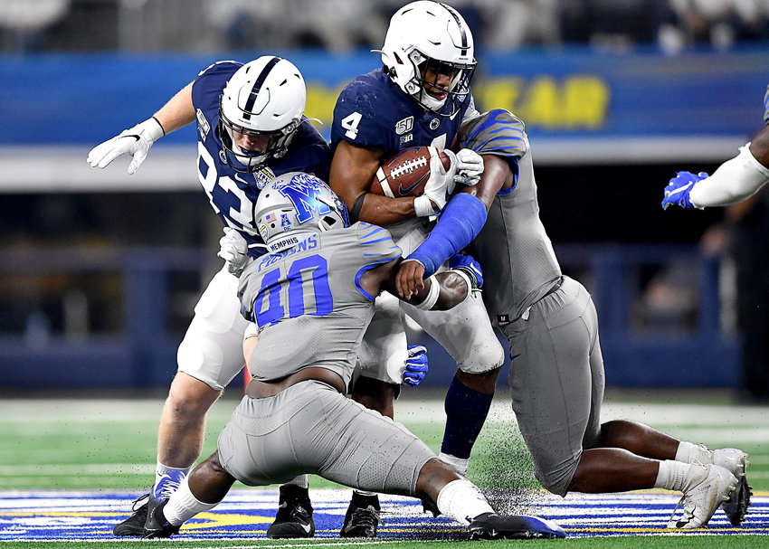 Memphis Tigers linebacker Thomas Pickens (40) and defensive back Sanchez Blake Jr. (41) try to contain Penn State Nittany Lions running back Journey Brown (4) late in the fourth quarter of the Cotton Bowl NCAA football game  Saturday, Dec. 28, 2019, at AT&T Stadium in Arlington, Texas.