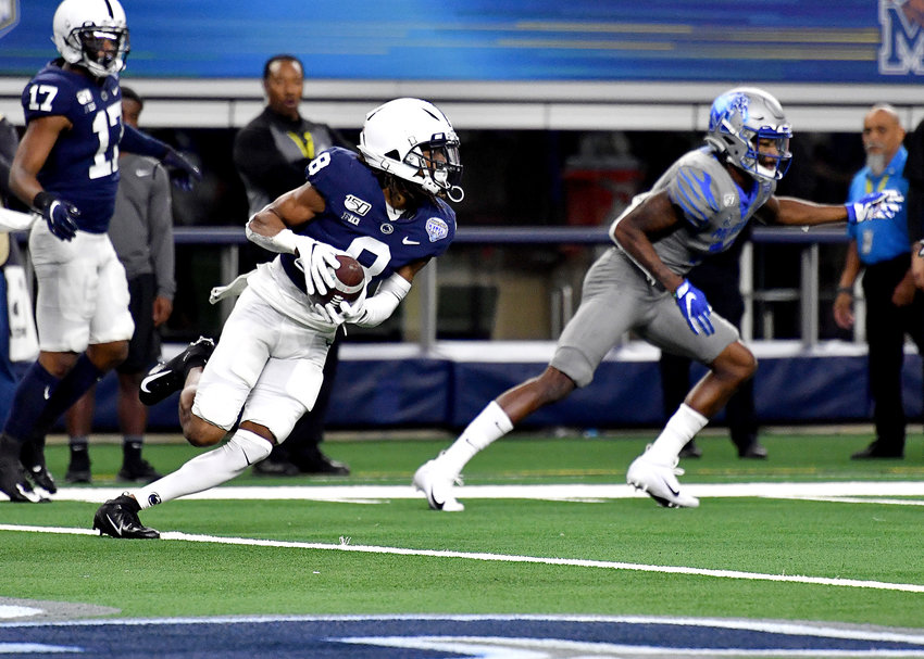 Penn State Nittany Lions cornerback Marquis Wilson (8) intercepts a pass late in the fourth quarter that would seal the fate of the Memphis Tigers in the Cotton Bowl NCAA football game Saturday, Dec. 28, 2019, at AT&T Stadium in Arlington, Texas.