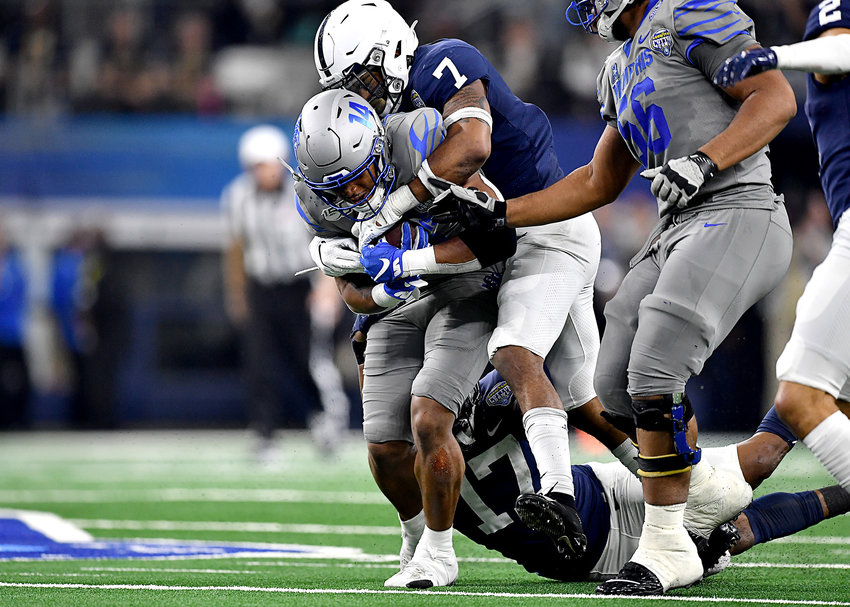 Memphis Tigers wide receiver Antonio Gibson (14) is tackled after a long run and a first down in the second half of the Cotton Bowl NCAA football game against the Penn State Nittany Lions Saturday, Dec. 28, 2019, at AT&T Stadium in Arlington, Texas.