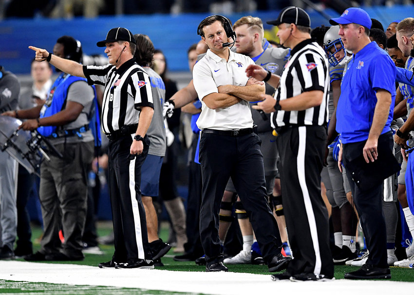 Memphis Tigers head coach Ryan Silverfield talks with an official on the sidelines during the second half of the Cotton Bowl NCAA football game against the Penn State Nittany Lions Saturday, Dec. 28, 2019, at AT&T Stadium in Arlington, Texas.
