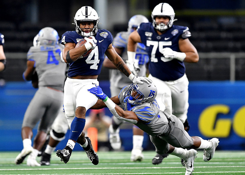 Penn State Nittany Lions running back Journey Brown (4) finds a hole in the line and takes off on a long run in the second half of the Cotton Bowl NCAA football game against the Memphis Tigers Saturday, Dec. 28, 2019, at AT&T Stadium in Arlington, Texas.