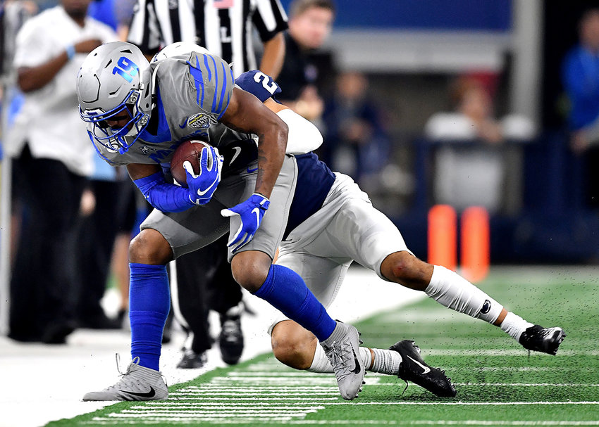 Memphis Tigers running back Kenneth Gainwell (19) makes the catch for a first down during the second half of the Cotton Bowl NCAA football game against the Penn State Nittany Lions Saturday, Dec. 28, 2019, at AT&T Stadium in Arlington, Texas.