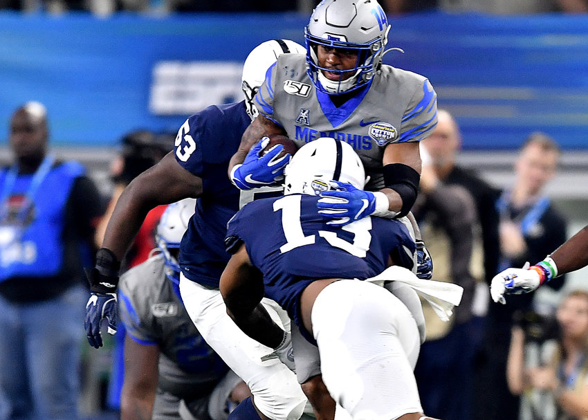Memphis Tigers wide receiver Antonio Gibson (14) adds yards after the catch during the second half of the Cotton Bowl NCAA football game against the Penn State Nittany Lions Saturday, Dec. 28, 2019, at AT&T Stadium in Arlington, Texas.