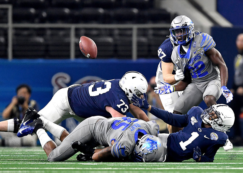 Memphis Tigers linebacker Tim Hart (35) hits Penn State Nittany Lions wide receiver KJ Hamler (1) hard enough to cause a fumble, afterward ruled an incomplete pass, during the second half of the Cotton Bowl NCAA football game Saturday, Dec. 28, 2019, at AT&T Stadium in Arlington, Texas.