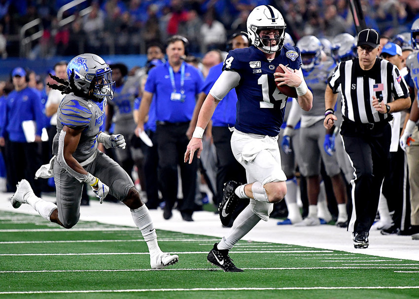 Penn State Nittany Lions quarterback Sean Clifford (14) with a keeper for a first down in the first half of the Cotton Bowl NCAA football game against the Memphis Tigers Saturday, Dec. 28, 2019, at AT&T Stadium in Arlington, Texas.
