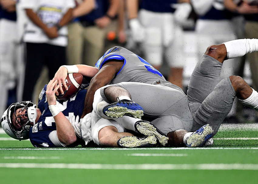 Memphis Tigers defensive end Bryce Huff (55) and defensive back Chris Claybrooks (7) sack Penn State Nittany Lions quarterback Sean Clifford (14) in the first half of the Cotton Bowl NCAA football game Saturday, Dec. 28, 2019, at AT&T Stadium in Arlington, Texas.