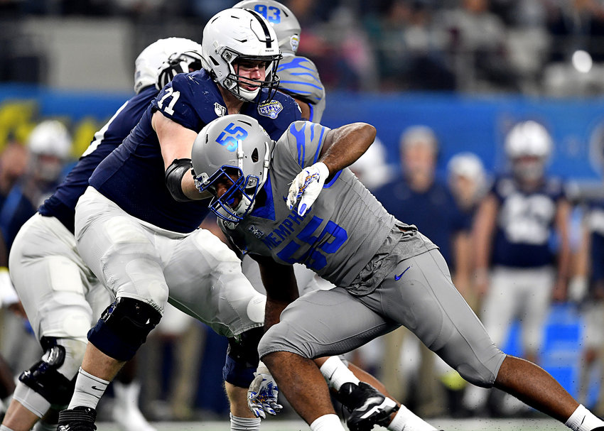 Memphis Tigers defensive end Bryce Huff (55) works to get by Penn State Nittany Lions linebacker Micah Parsons (11) in the first half of the Cotton Bowl NCAA football game  Saturday, Dec. 28, 2019, at AT&T Stadium in Arlington, Texas.
