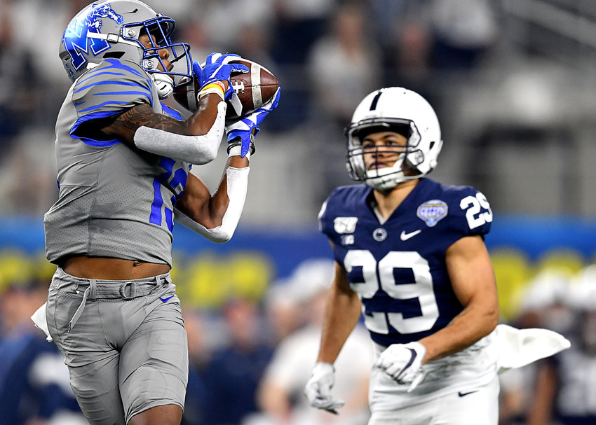 Memphis Tigers wide receiver Kedarian Jones (13) with an off-pace catch for a first down during the first half of the Cotton Bowl NCAA football game against the Penn State Nittany Lions Saturday, Dec. 28, 2019, at AT&T Stadium in Arlington, Texas.
