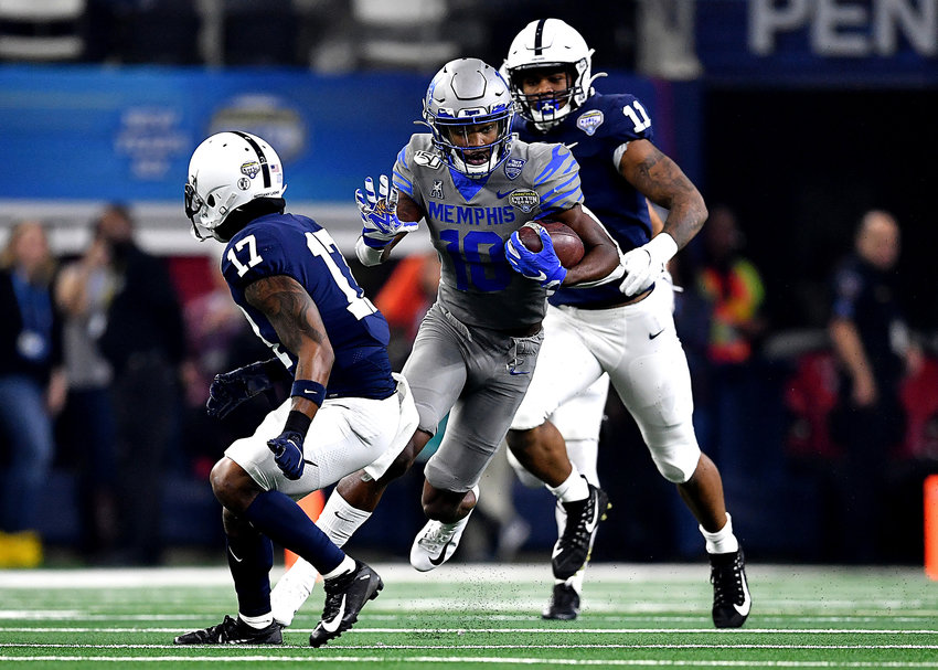 Memphis Tigers wide receiver Damonte Coxie (10) looks for open field after the reception during the first half of the Cotton Bowl NCAA football game against the Penn State Nittany Lions Saturday, Dec. 28, 2019, at AT&T Stadium in Arlington, Texas.