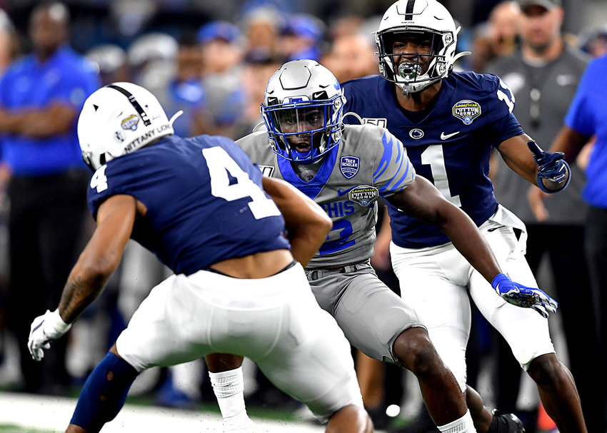 Memphis Tigers defensive back Jacobi Francis (32) gets ready to tackle Penn State Nittany Lions running back Journey Brown (4) in the first quarter of the Cotton Bowl NCAA football game Saturday, Dec. 28, 2019, at AT&T Stadium in Arlington, Texas.
