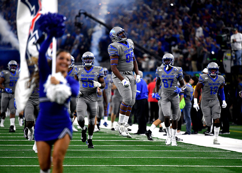 The Memphis Tigers take the field prior to the start of the Cotton Bowl NCAA football game against the Penn State Nittany Lions Saturday, Dec. 28, 2019, at AT&T Stadium in Arlington, Texas.