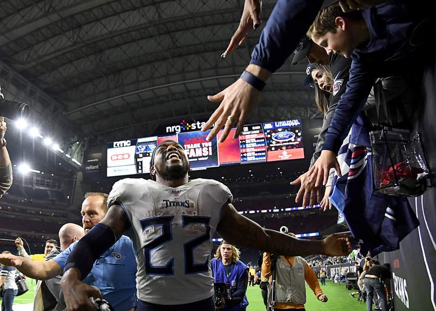 Tennessee Titans running back Derrick Henry (22) celebrates with fans following the Titans' 35-14 win over the Houston Texans Sunday, Dec. 29, 2019, at NRG Stadium in Houston, Texas.