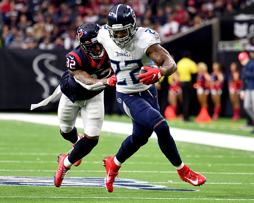 Houston Texans cornerback Lonnie Johnson (32) tries to stop Tennessee Titans running back Derrick Henry (22) in the first half of an NFL game Sunday, Dec. 29, 2019, at NRG Stadium in Houston Texas.