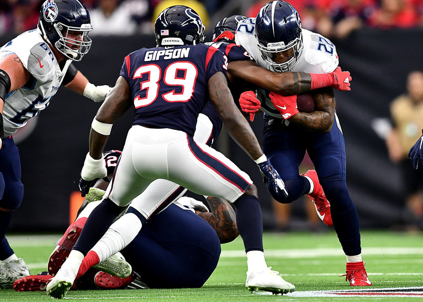 Tennessee Titans running back Derrick Henry (22) tries to find a gap during the first half of an NFL game against the Houston Texans Sunday, Dec. 29, 2019, at NRG Stadium in Houston Texas.