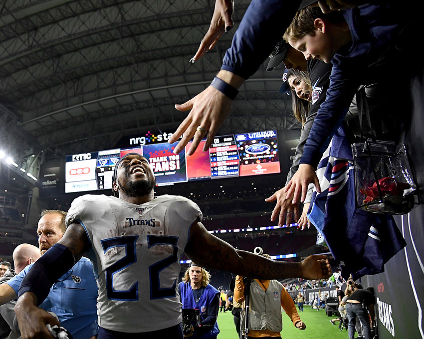 Tennessee Titans running back Derrick Henry (22) celebrates with Titans fans following the win over the Houston Texans Sunday, Dec. 29, 2019, at NRG Stadium in Houston Texas.