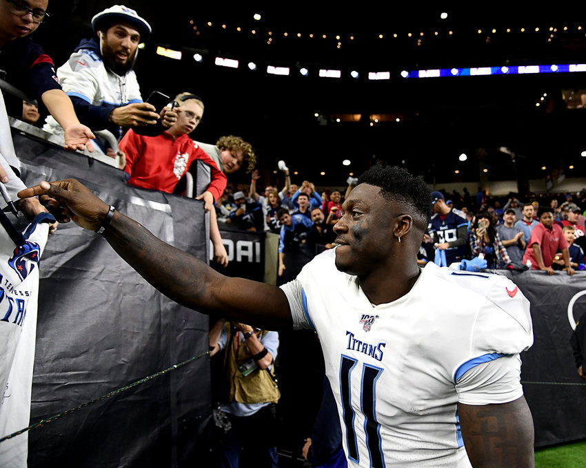 Tennessee Titans wide receiver A.J. Brown (11) signs an autograph prior to leaving the field following the win over the Houston Texans Sunday, Dec. 29, 2019, at NRG Stadium in Houston, Texas..