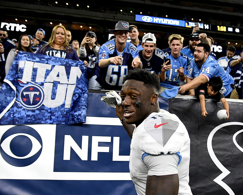 Tennessee Titans wide receiver A.J. Brown (11) interacts with Titans fans prior to the end of the fourth quarter of an NFL game against the Houston Texans Sunday, Dec. 29, 2019, at NRG Stadium in Houston Texas.