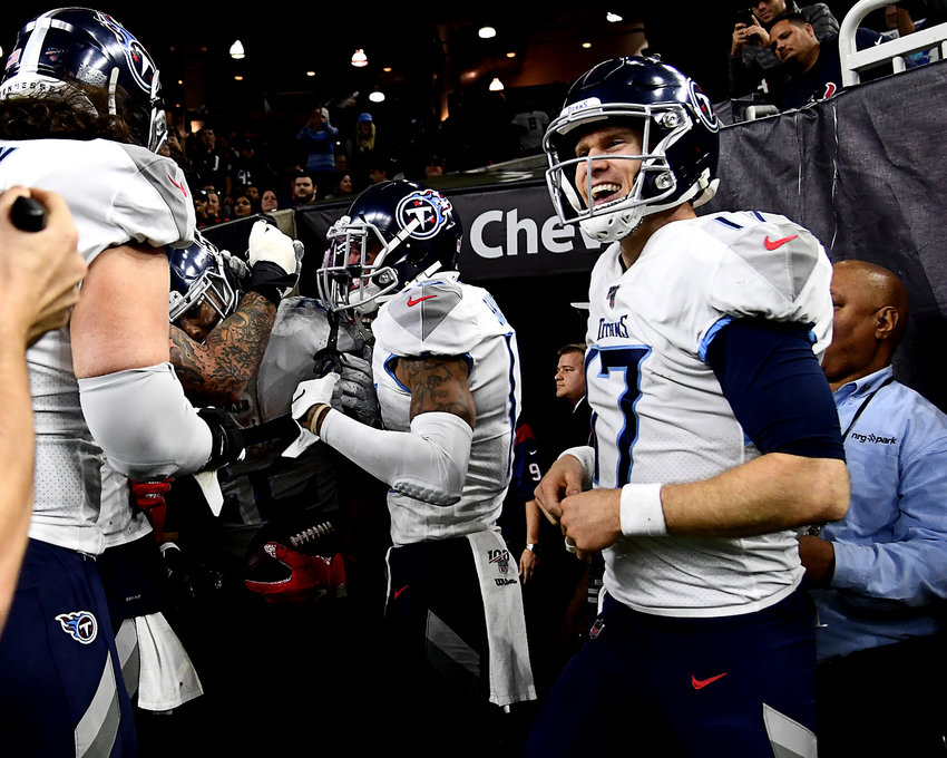 Tennessee Titans quarterback Ryan Tannehill (17) celebrates running back Derrick Henry's (22) touchdown late in the fourth quarter of an NFL game Sunday, Dec. 29, 2019, at NRG Stadium in Houston Texas.