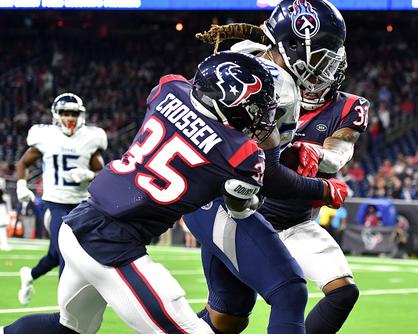 Tennessee Titans running back Derrick Henry (22) on his way to a touchdown in the fourth quarter of an NFL game against the Houston Texans Sunday, Dec. 29, 2019, at NRG Stadium in Houston Texas. This 53-yard run also gave Henry, with 1,540 rushing yards for the season, the title of NFL's leading rusher for 2019.